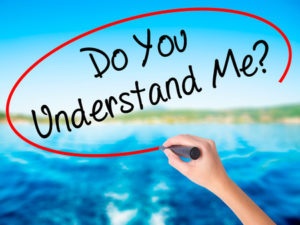 65141361 - woman hand writing do you understand me? on blank transparent board with a marker isolated over water background. business concept. stock photo