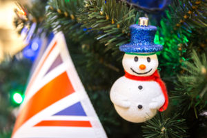 72796713 - christmas tree decoration with british flag and snowman